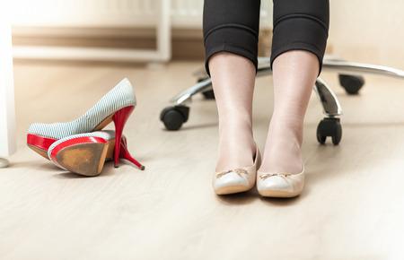 33990809 - closeup photo of businesswoman wearing ballet flats